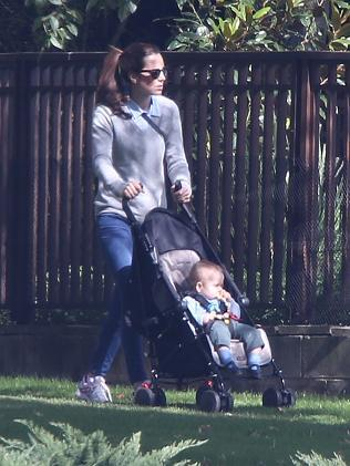 The Duchess of Cambridge on a day off, strolling around the pristine grounds of Government House with her young son George, in Canberra.