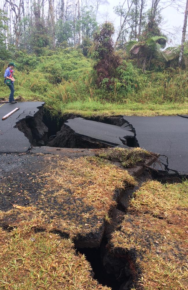 A Hawaiian Volcano Observatory geologist monitors quake damage in Leilani Estates, Pahoa. Cracks caused by the underlying intrusion of magma expanded significantly during the past 24 hours, some with horizontal and vertical offsets. Picture: US Geological Survey via AP