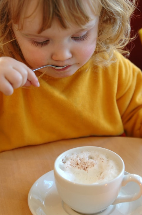 child enjoying milk froth