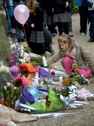Flowers and messages in honour of the van den Hende family. Picture : Mike Keating.