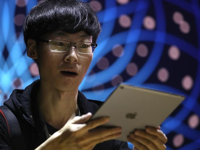 An attendee inspects the iPad Pro during the 2017 Apple Worldwide Developer Conference. Picture: Justin Sullivan