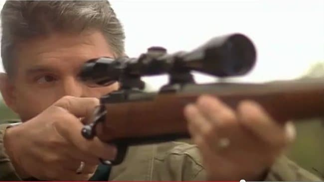 In a campaign video, Democrat Joe Manchin affirms his support for the constitutional right to bear arms, then loads up a rifle and puts a bullet through a piece of unpopular legislation. Picture: YouTube.com