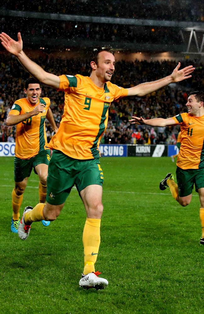 Josh Kennedy celebrates a goal for the Socceroos.
