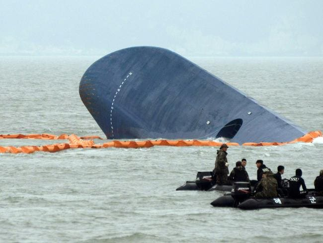 Deadly disaster ... South Korean coast guards search for passengers near the ferry that capsized on its way to Jeju island from Incheon. Picture: Ed Jones