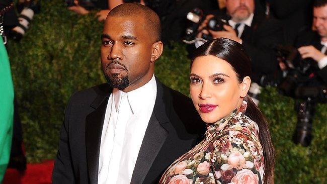 Kanye West took the Met Costume Gala's punk theme to heart - belting out screams into the microphone instead of performing his hits for the posh crowd. Above, West and girlfriend Kim Kardashian walk the red carpet at the event. Picture: Getty