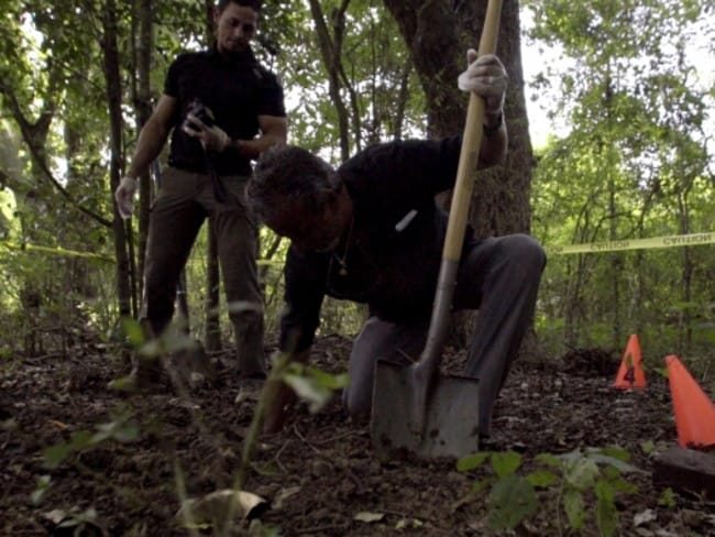 Detectives Sanchez and St Angelo literally digging for clues in a scene from real-time crime documentary <i>Killing Fields</i>. Picture: Discovery