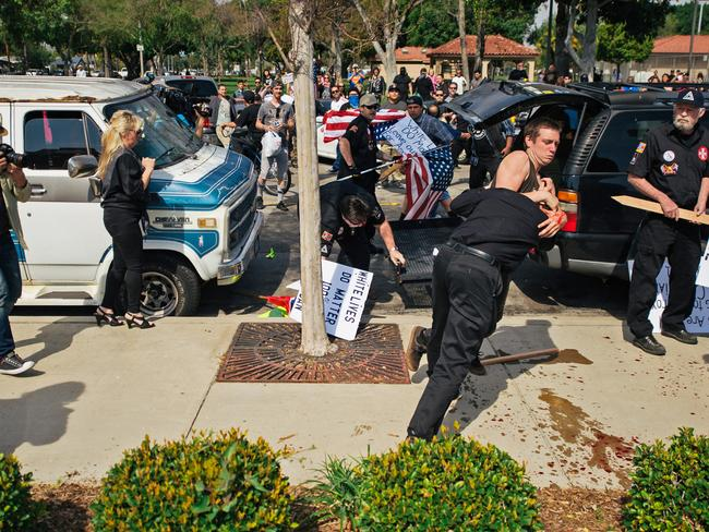 Violence erupts ... This photo shows counter-protesters scuffling with a KKK member as he stabs an attacking protester. Picture: AP.