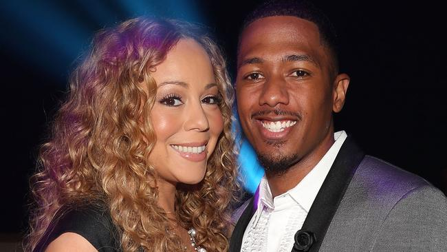 In her face ... Carey and husband, TV host Nick Cannon. Picture: Christopher Polk
