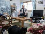 Kouichi Nozawa who lives with his wife Youko in a room in temporary housing Fukushima, Japan. Picture: Arkadiusz Podniesinski/REX Shutterstock /australscope