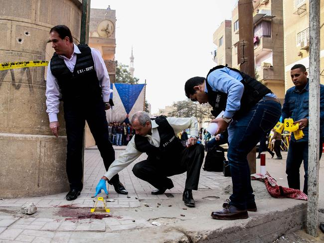Egyptian security members and forensic police inspect the site of the attack. Picture: AFP/Samer Abdallah