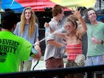 Security guards use hose to cool off fans. . Picture: Cameron Richardson