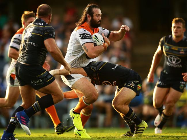 Aaron Woods charges the ball up and is tackled.