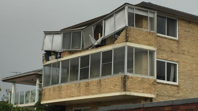 Balcony windows on the top floor of 14 Bellevue St, Maroubra after the tornado like winds went through the coastal areas of southern Sydney. Picture: John Grainger