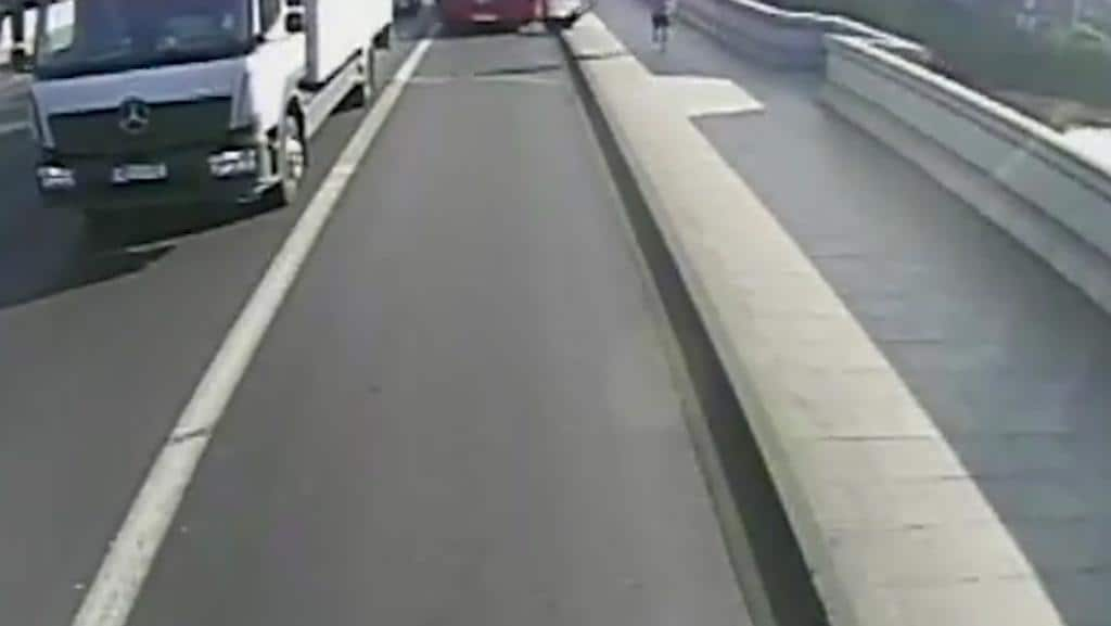 The woman falls into the road where a bus swerves to miss her. Picture: Metropolitan Police via AP