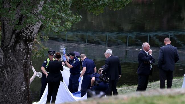 Police and detectives surround the body. Photo: Mike Burton, The Advertiser
