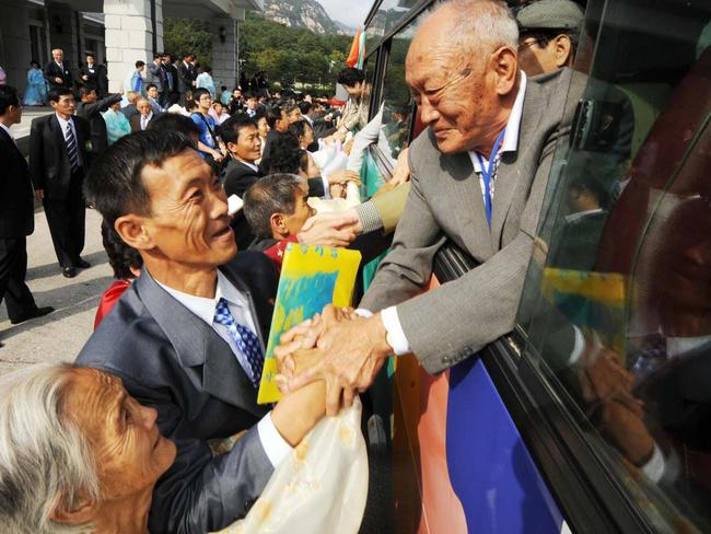 North Koreans take the hands of their departing South Korean family members as they bid farewell following their three-day family reunion in 2009. Picture: Republic of Korea/AFP