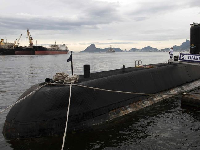 "CORRECTION - View of Brazilian submarine Timbira anchored during a presentation to the press in Rio de Janeiro, Brazil, on November 22, 2017, whilst other vessels and aircrafts of the Brazilian Navy are taking part in the international search mission for missing Argentine submarine ARA San Juan.  An international search mission for a missing Argentine submarine entered a critical phase Tuesday after nearly a week without signs of life -- as the vessel risked running out of oxygen after being submerged for so long. The ARA San Juan would have enough oxygen for its crew to survive underwater for seven days, if there was no hull breach, according to officials. At 0730 GMT Wednesday, that time will have elapsed.  / AFP PHOTO / LEO CORREA / ""The erroneous mention[s] appearing in the metadata of this photo by LEO CORREA has been modified in AFP systems in the following manner: [whilst other vessels and aircrafts of the Brazilian Navy are taking part in the international search mission for missing Argentine submarine ARA San Juan.] instead of [which takes part in the international search mission for the missing Argentine submarine ARA San Juan]. Please immediately remove the erroneous mention[s] from all your online services and delete it (them) from your servers. If you have been authorized by AFP to distribute it (them) to third parties, please ensure that the same actions are carried out by them. Failure to promptly comply with these instructions will entail liability on your part for any continued or post notification usage. Therefore we thank you very much for all your attention and prompt action. We are sorry for the inconvenience this notification may cause and remain at your disposal for any further information you may require."""