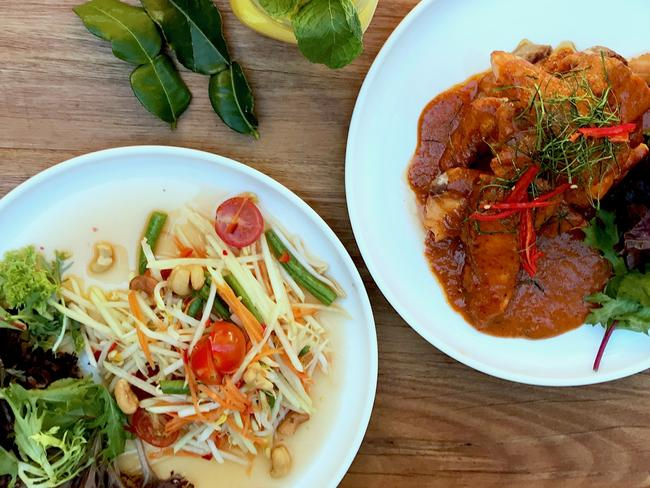 KukThai's papaya salad and Chu Chee Salmon. Picture: Jenifer Jagielski