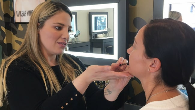 Lisa getting her makeup done by Rebecca Photo: Supplied