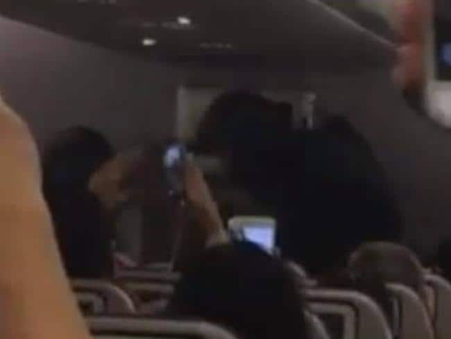 Passengers film heavily armed police on board the Malaysia Airlines flight. Picture: Dhana Sekaran