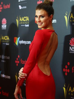 The former Miss World Australia stuns in red.