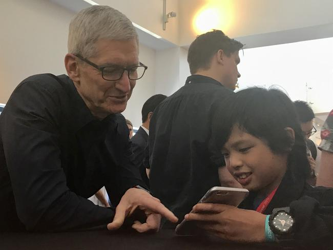 The youngest app developer at the WWDC is 10 year old Melbourne boy Yuma Soerianto pictured with Apple CEO Tim Cook. Picture: Rod Chester