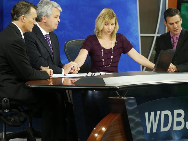 Heartbreaking ... WDBJ-TV7 news morning anchor Kimberly McBroom, second from right, and meteorologist Leo Hirsbrunner, right, are joined by visiting anchor Steve Grant, second from left, and Dr. Thomas Milam, of the Carilion Clinic, as they observe a moment of silence. Picture: AP Photo/Steve Helber