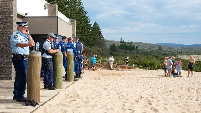 Police and paramedics line the beach as the search gets underway. Picture: Alison Newbold