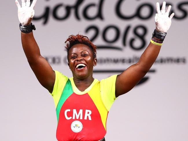 Arcangeline Fouodji Sonkbou of Cameroon waves to the crowd after the Women's 69 kilogram final at Carrara Sports and Leisure Centre. Picture: Mark Kolbe/Getty Images