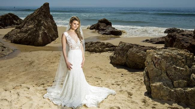 Model Karina Jones wearing a dress from Pearl Bridal at Miami Beach. Photo: Jerad Williams.