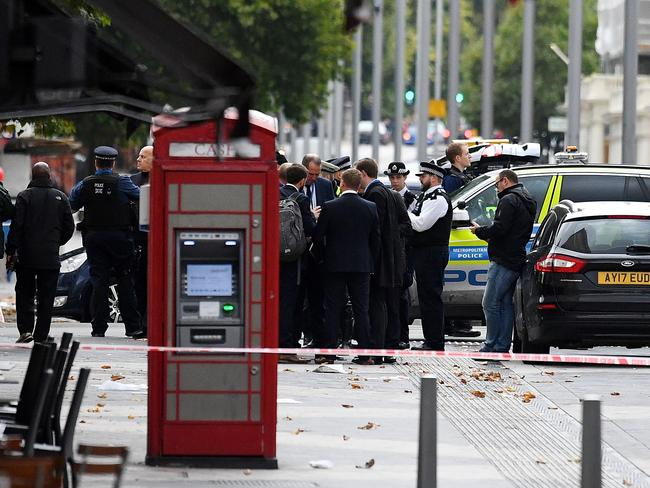 Police officers speak to members of the public on Exhibition Road after a car mounted the pavement and collided with pedestrians outside the Natural History Museum. Picture: Getty