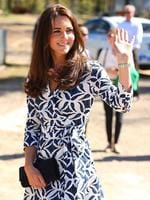 Catherine, Duchess of Cambridge waves to onlookers as she arrives at the Winmalee Guide Hall. Picture: Getty