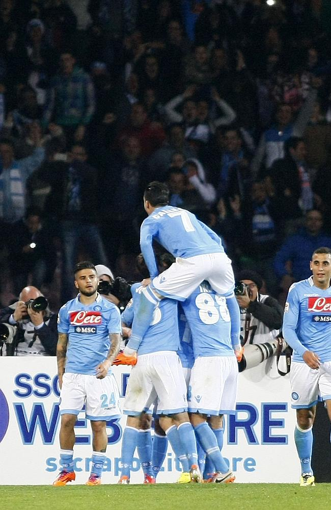 Napoli's players celebrate after scoring against Juventus.