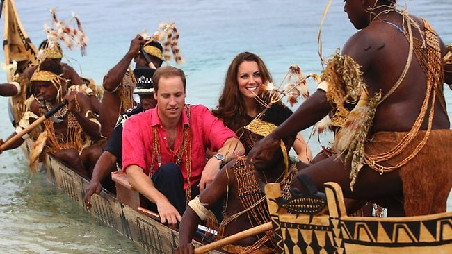 Part of the tribe: William and Kate make their way to Tavanipupu in a traditional war canoe.