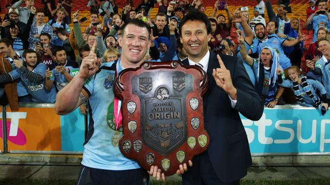 Paul Gallen and Laurie Daley celebrate with the State of Origin shield in 2014. Picture: Gregg Porteous