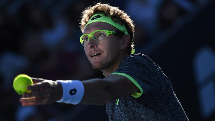 TOPSHOT - Uzbekistan's Denis Istomin serves against Spain's Pablo Carreno Busta during their men's singles third round match on day six of the Australian Open tennis tournament in Melbourne on January 21, 2017. / AFP PHOTO / GREG WOOD / IMAGE RESTRICTED TO EDITORIAL USE - STRICTLY NO COMMERCIAL USE