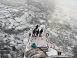 Passengers stand on a deck of a tourist boat with restaurant aboard especially designed for winter river cruises as it breaks through the frozen Moskva River in Moscow, Russia, Monday, Feb. 26, 2018. Picture: AP Photo/Alexander Zemlianichenko
