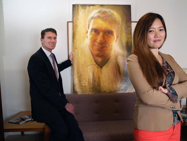 IN THE FRAME: Senator Bernardi and the portrait to be entered in the Archibald Prize, with Korean artist Shine Ok. Picture: GARY RAMAGE