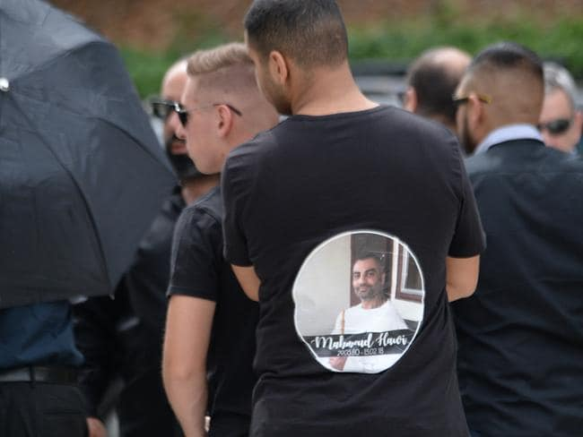 A mourner at Mahmoud Hawi's funeral wears a special T-shirt. Picture: Jeremy Piper