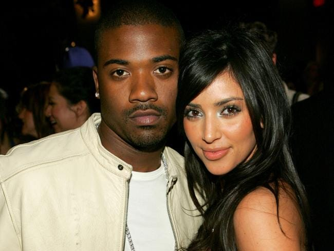 Early days ... Kardashian with her former partner, Ray J.