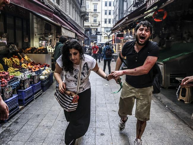 Injured protesters make their escape in Istanbul ... Turkey's combative prime minister warned protesters that police would do 'whatever is necessary' to clamp down on demonstrations. Picture: Gurcan Ozturk