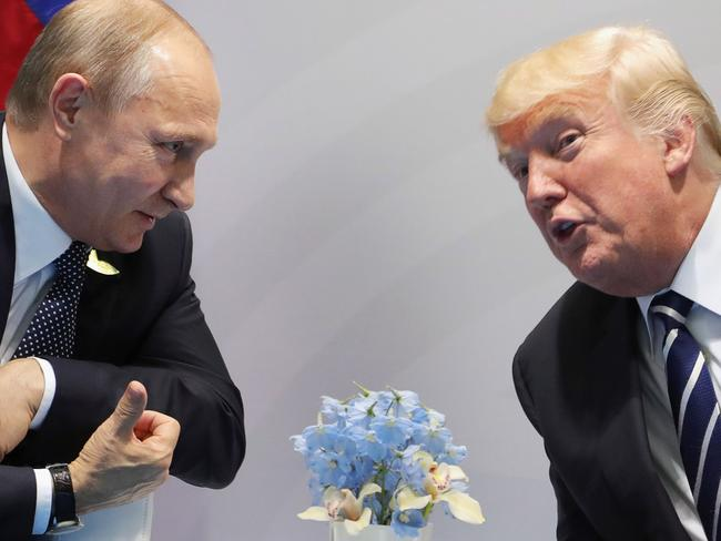 US President Donald Trump and Russia's President Vladimir Putin speak during their meeting on the sidelines of the G20 Summit in Hamburg, Germany. Picture: AFP