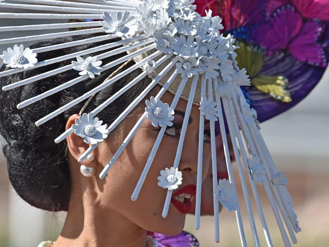 Competitors from around the world prepare for the annual Fashion on the Field competition at Flemington Racecourse on Melbourne Cup day in Melbourne on November 3, 2015. Picture: AFP PHOTO/Paul CROCK