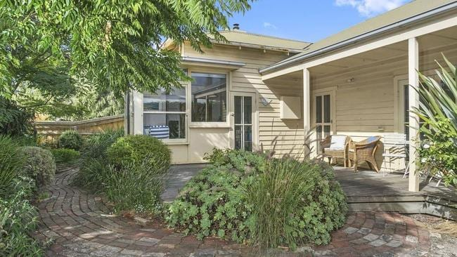 The weatherboard house is full of charm.
