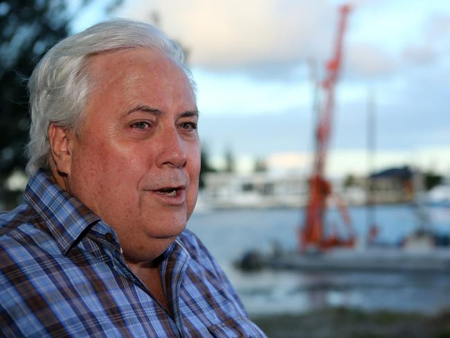 Clive Palmer talks to the media on the Esplanade at Paradise Point, Gold Coast. Pic Jono Searle.