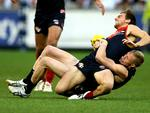 Jack Frost tackles Dom Tyson. Picture: Wayne Ludbey