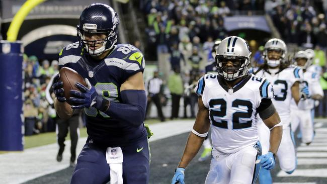 Seattle Seahawks' Jimmy Graham, left, runs for a touchdown.