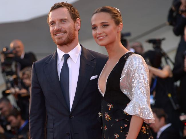 Fassbender, pictured with his Swedish actor wife Alicia Vikander, has never commented on the allegations. Picture: AFP Photo/Filippo Monteforte