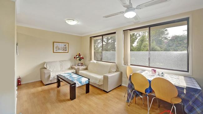 The two-bedroom house at Cotula Place, Macquarie Fields, is in good condition.