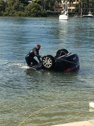 The car is fished out of the water. Picture: Stuart Cooper